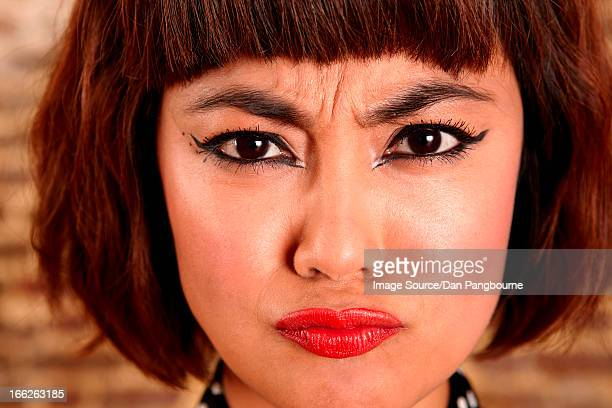 Close up of woman's frowning face