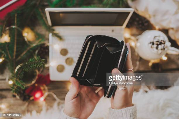 close up of woman's hand holding empty wallet - christmas cash stock pictures, royalty-free photos & images