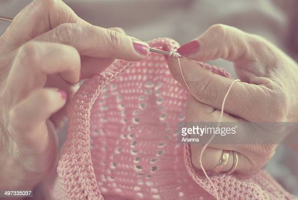 Close up of woman's hands crocheting