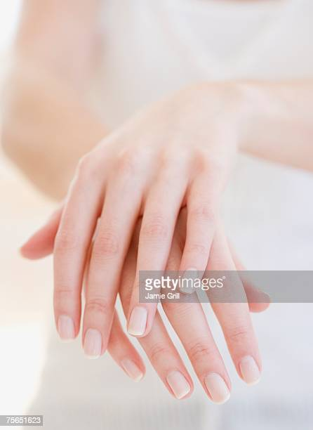 close up of woman's hands - manicure stock pictures, royalty-free photos & images