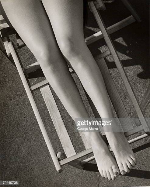 Close up of woman's legs on lounge chair