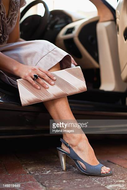 close up of womans shoes and purse - pochette borsetta foto e immagini stock