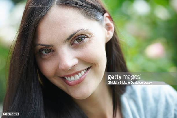 close up of womans smiling face - saint ferme stock pictures, royalty-free photos & images