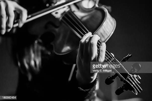 Close up of women playing a violin