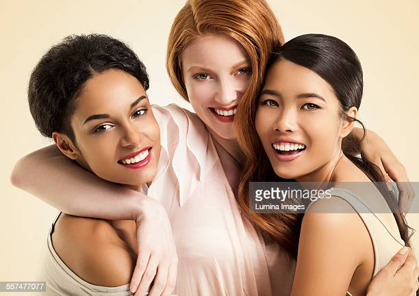 Close up of women smiling and hugging