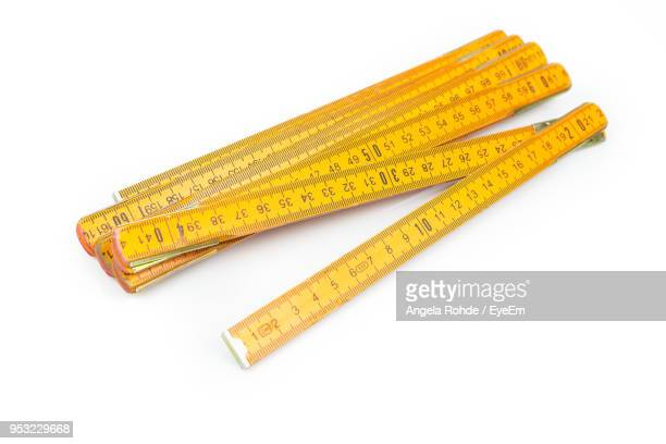 close up of wooden rulers over white background - ruler stock photos and pictures