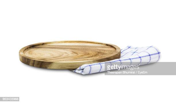 close up of wooden serving board with napkin against white background - napkin stock pictures, royalty-free photos & images