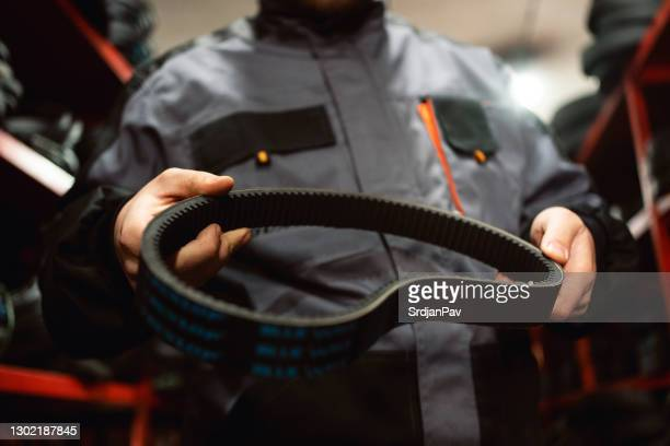 close up of  worker holding a rubber belt - belt stock pictures, royalty-free photos & images