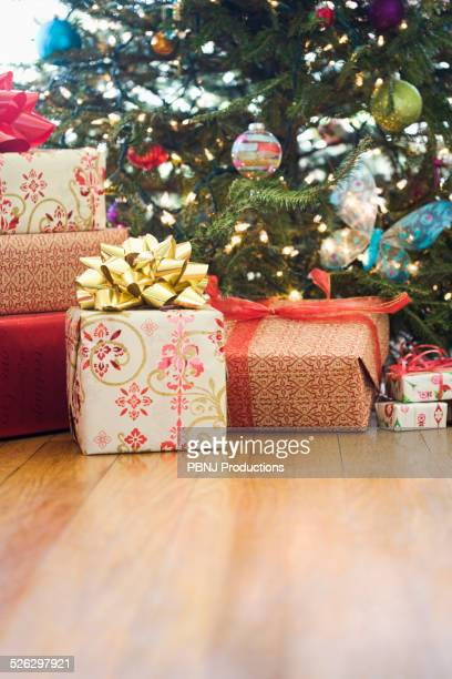 Close up of wrapped gifts under Christmas tree