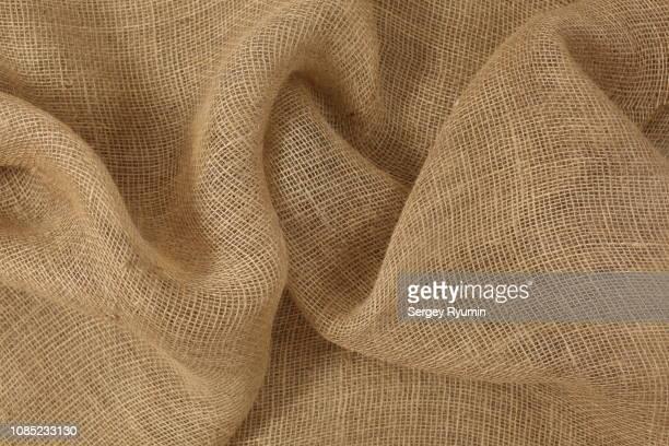 close up of wrinkled burlap - 荒い麻布 ストックフォトと画像
