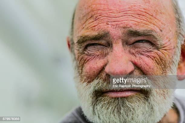 Close up of wrinkled face of Caucasian man
