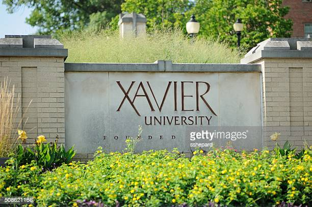 close up of xavier university sign - cincinnati stock pictures, royalty-free photos & images