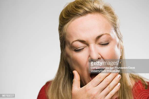 close up of yawning woman - yawning stock pictures, royalty-free photos & images