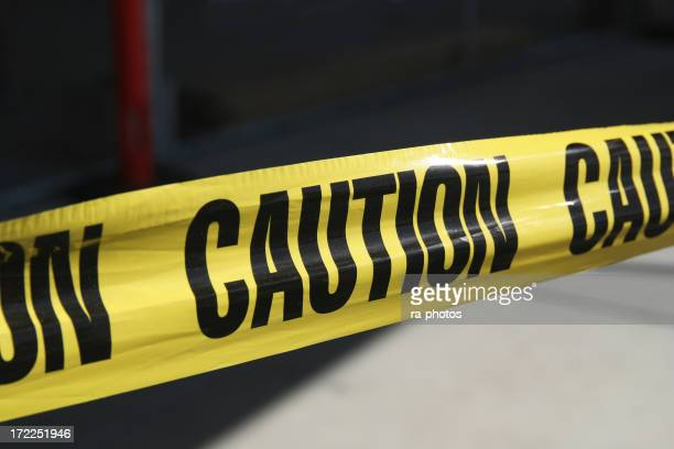 Close up of yellow caution tape