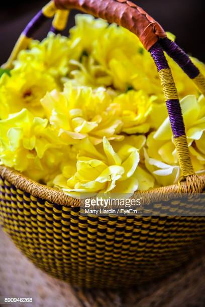 close up of yellow flowers in basket - marty hardin stock photos and pictures