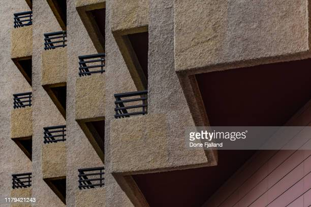 close up of yellow stone wall with windows making a geometric pattern - dorte fjalland stock pictures, royalty-free photos & images
