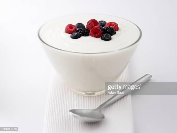 close up of  yogurt and fruit - adam berry stock-fotos und bilder