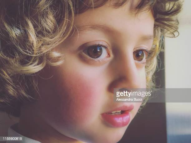close up of young boy daydreaming - dreaming stock pictures, royalty-free photos & images