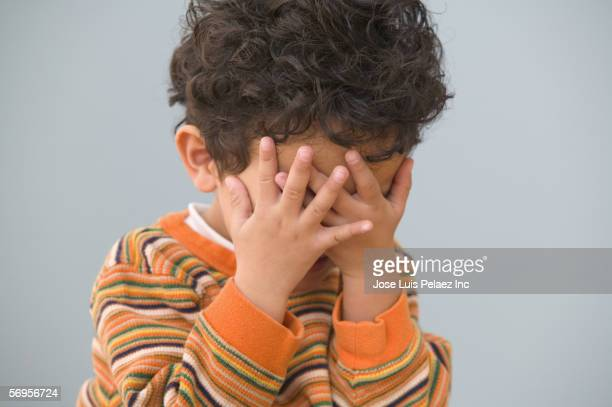 close up of young boy with hands over face - hands covering eyes stock pictures, royalty-free photos & images