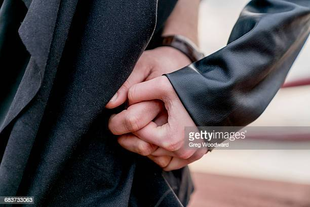 close up of young couple hand in hand - his and hers stock pictures, royalty-free photos & images