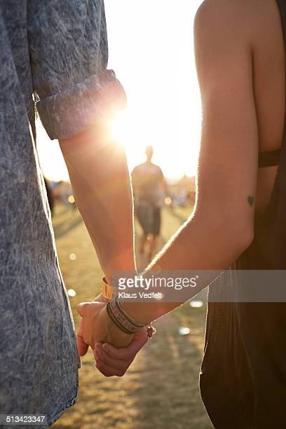 Close- up of young couple holding hands