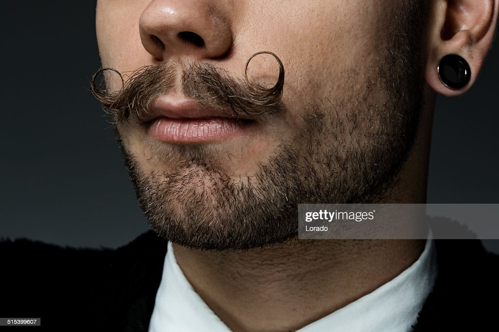 close up of young man with long moustaches : Stock Photo