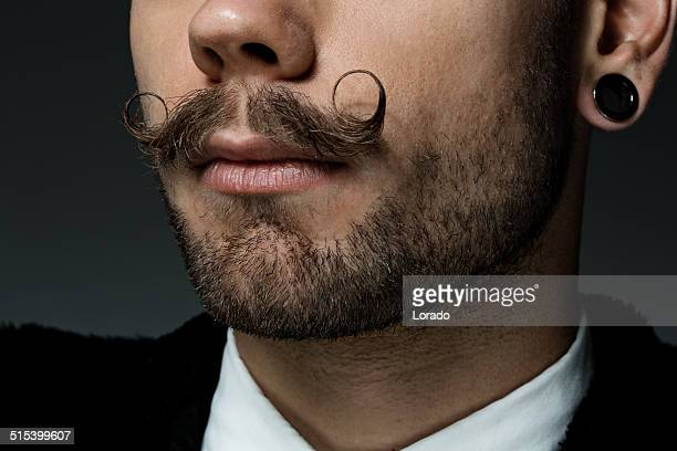 close up of young man with long moustaches