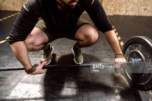 close up of young weightlifter preparing for dead-lifting - strap stock pictures, royalty-free photos & images