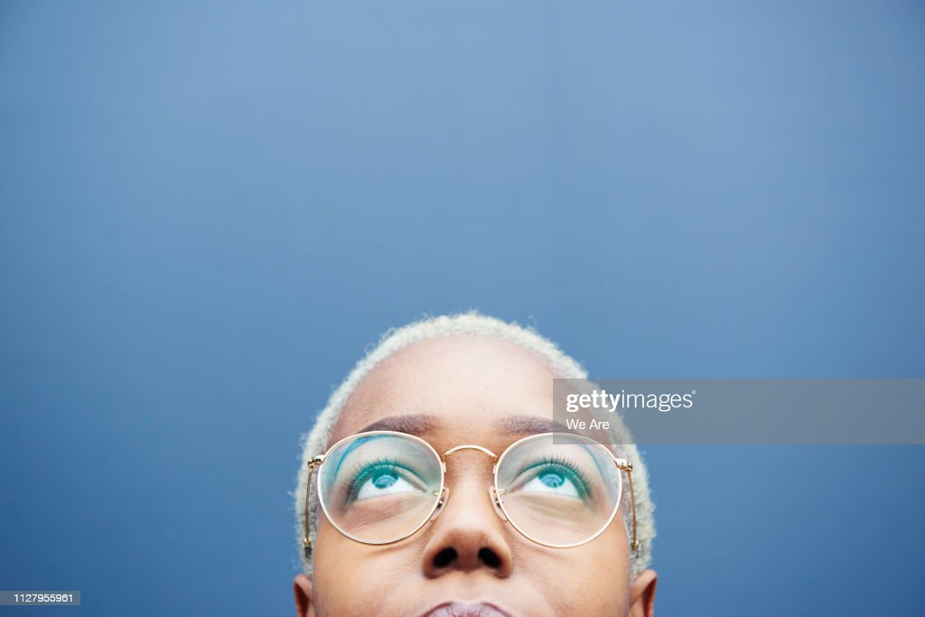 Close up of young woman looking up. : Stock Photo