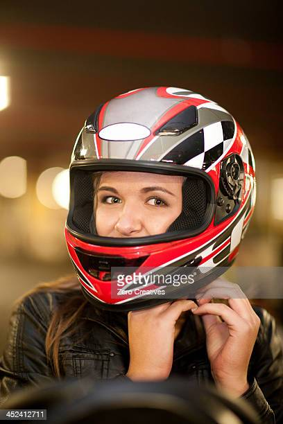 close up of young woman on go cart - sportschutzhelm stock-fotos und bilder