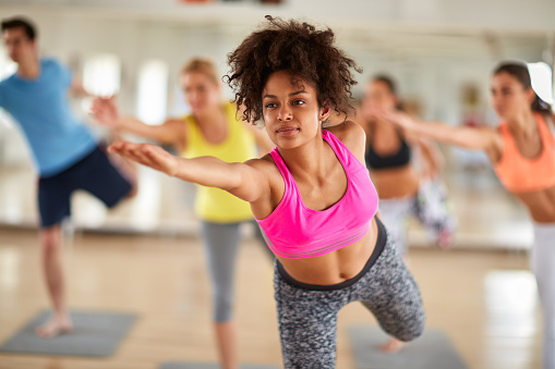 Close up of young woman on stretching training indoor 539334448