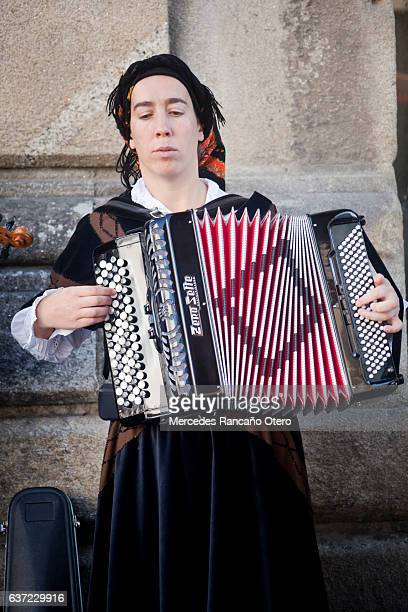 Close up of young woman playing accordion.