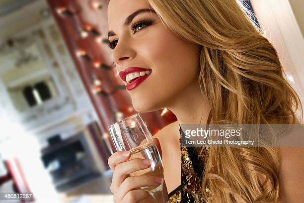 Close up of young woman with glass of champagne