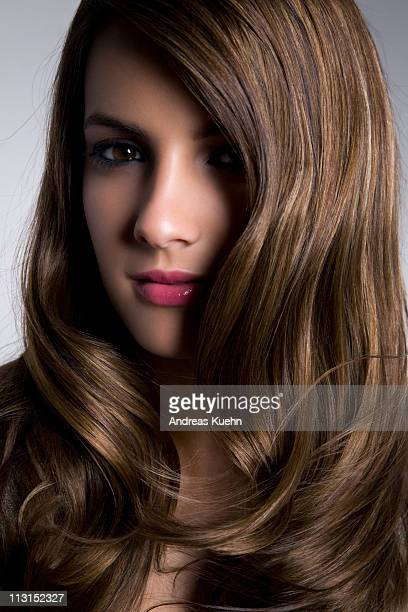 close up of young woman with shiny hair. - dominican ethnicity stock photos and pictures