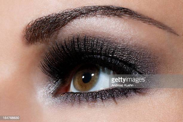 Close up of young woman's eye with make up.