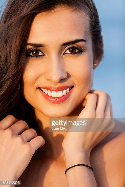 Close up of young woman's face at the beach