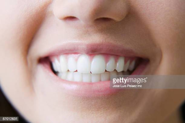 close up of young woman's smile - denti foto e immagini stock