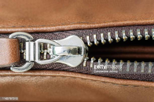 close up of zipper and leather bag - leather purse stock pictures, royalty-free photos & images