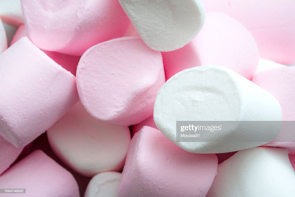 Close up on a heap of marshmallow sweets with copyspace : Stock Photo