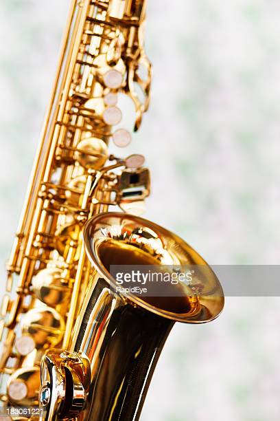 Close up on bell of shiny golden saxophone