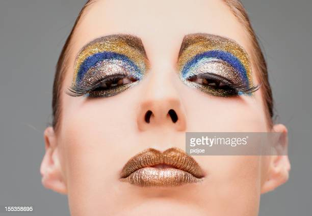 close up on face with multi colored make-up