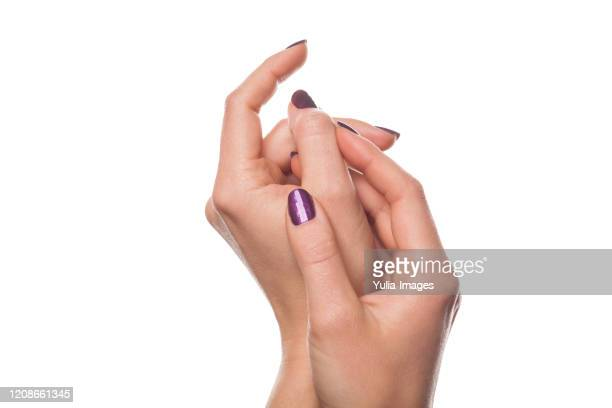 close up on hands in relaxed gesture - enamel stock pictures, royalty-free photos & images