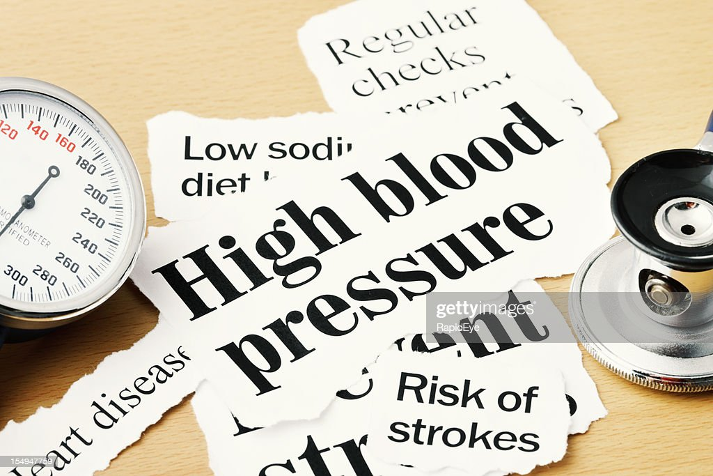 Close up on high blood pressure headlines with medical instruments : Stock Photo
