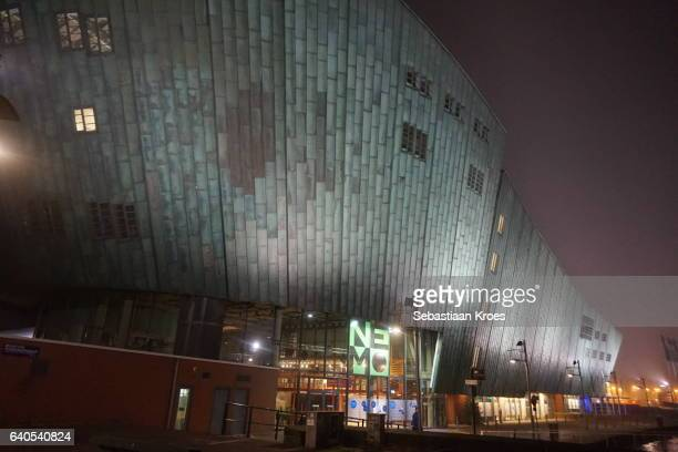 close up on neom museum at night, amsterdam, the netherlands - nemo museum stock pictures, royalty-free photos & images
