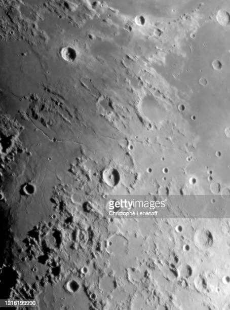 close up on rima hyginus and ariadaeus on the moon - flower moon stock pictures, royalty-free photos & images