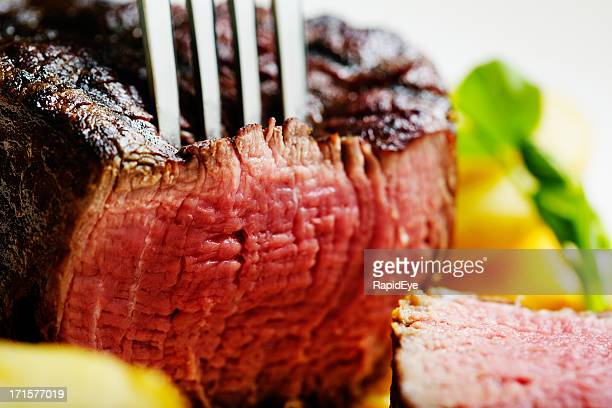 Close up on slice of juicy grilled beef fillet