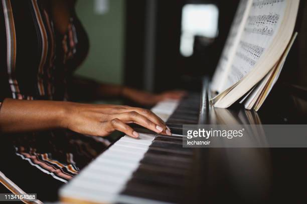 close up on the hands of a piano player - piano stock pictures, royalty-free photos & images