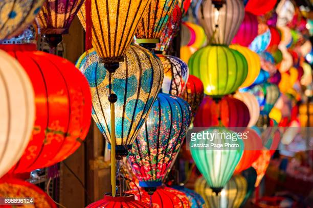 Close up on the lit lanterns of a shop in Hoi An, Vietnam