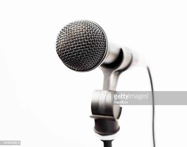 Close up on vocal microphone against white