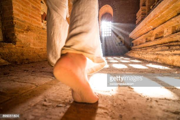Close up on woman's barefoot walking in ancient temple in Bagan, Myanmar